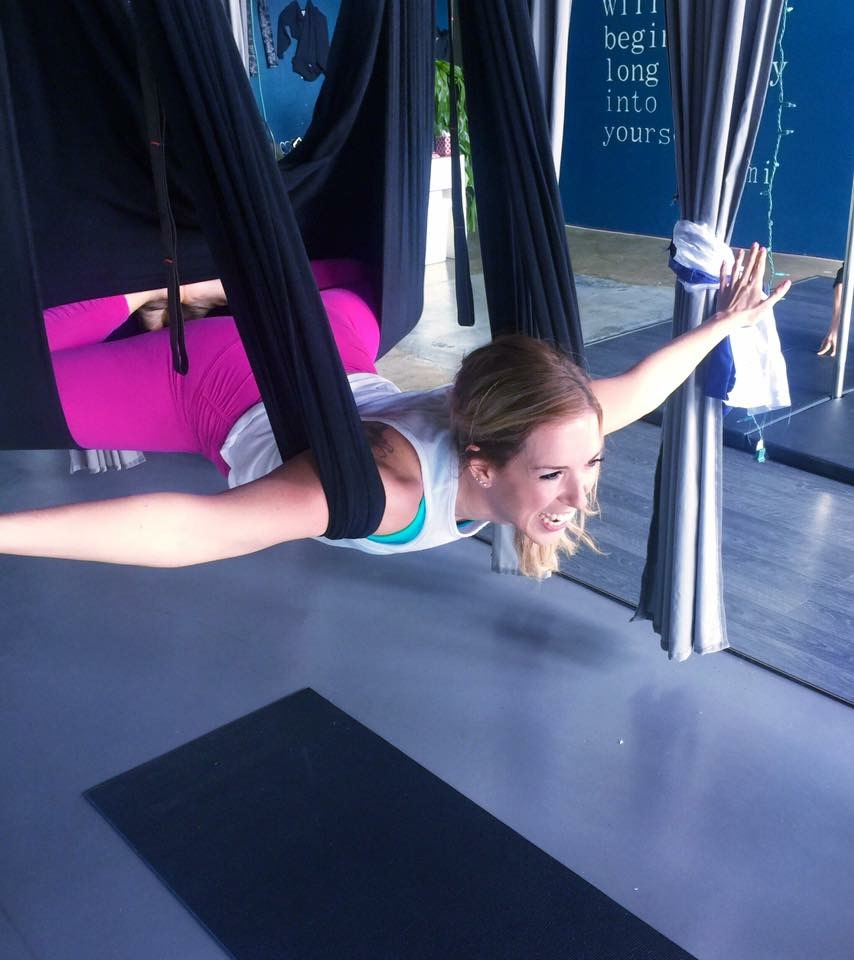 aerial yoga flying squirrel pose